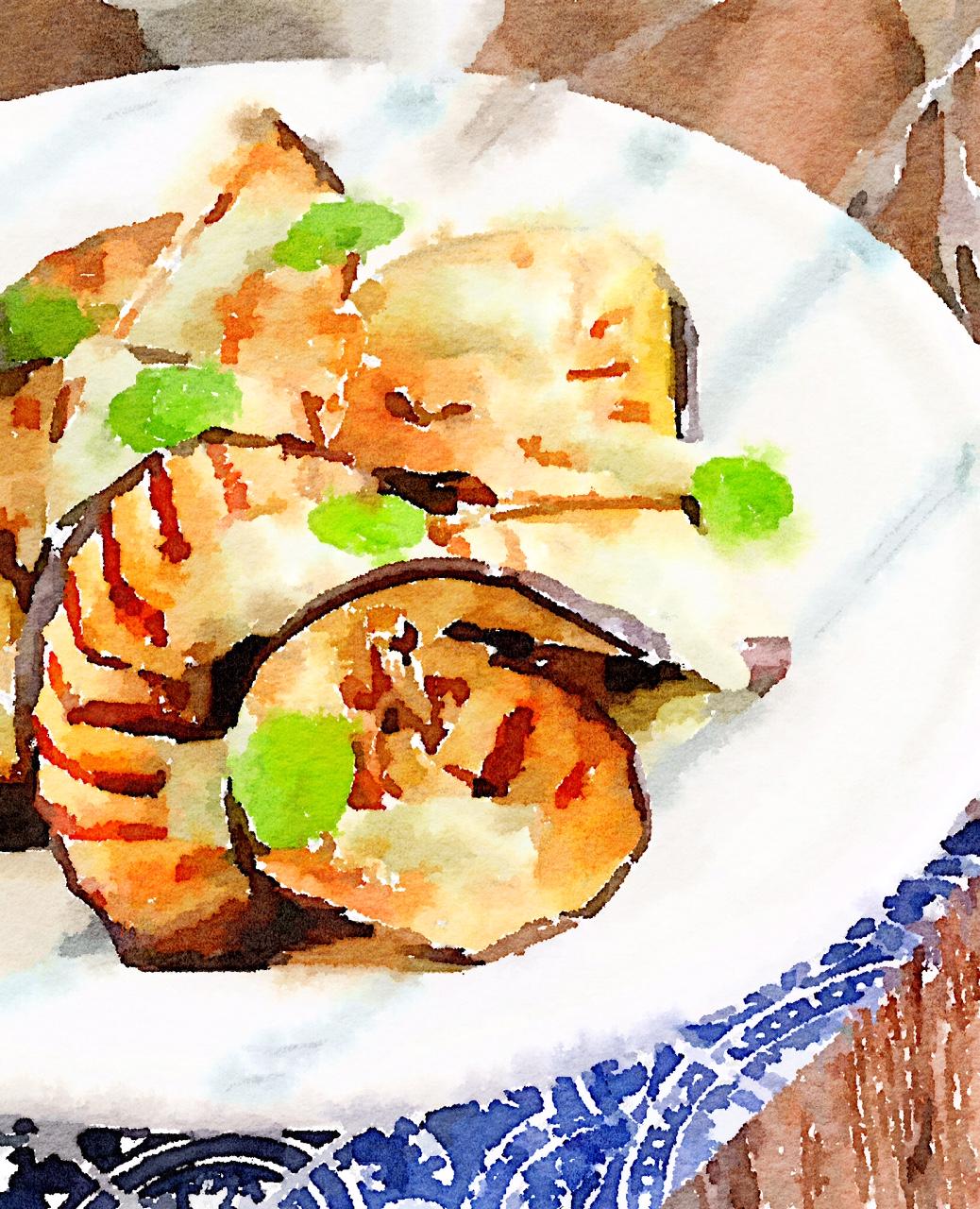 Spicchi di melanzane alla griglia con yogurt greco, olive e menta